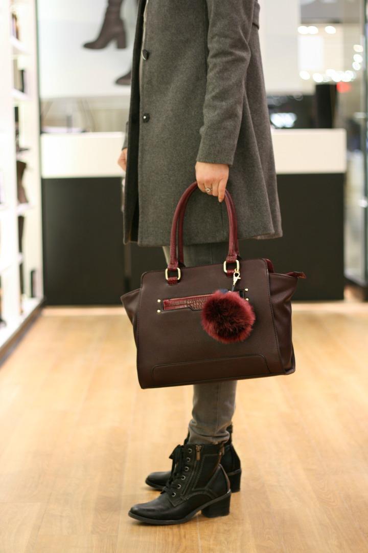 aldo bag with pom pom