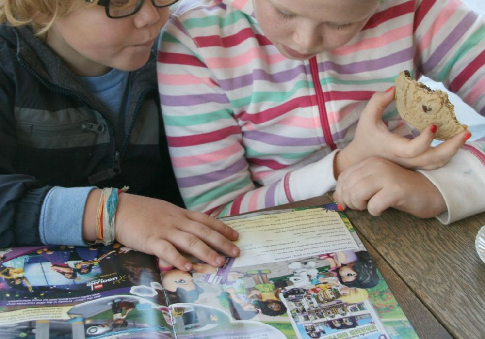 herschel looking at lego magazine