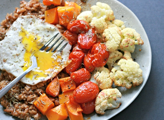 Whole Bowls roasted vegetable bowls with fried eggs and goat cheese