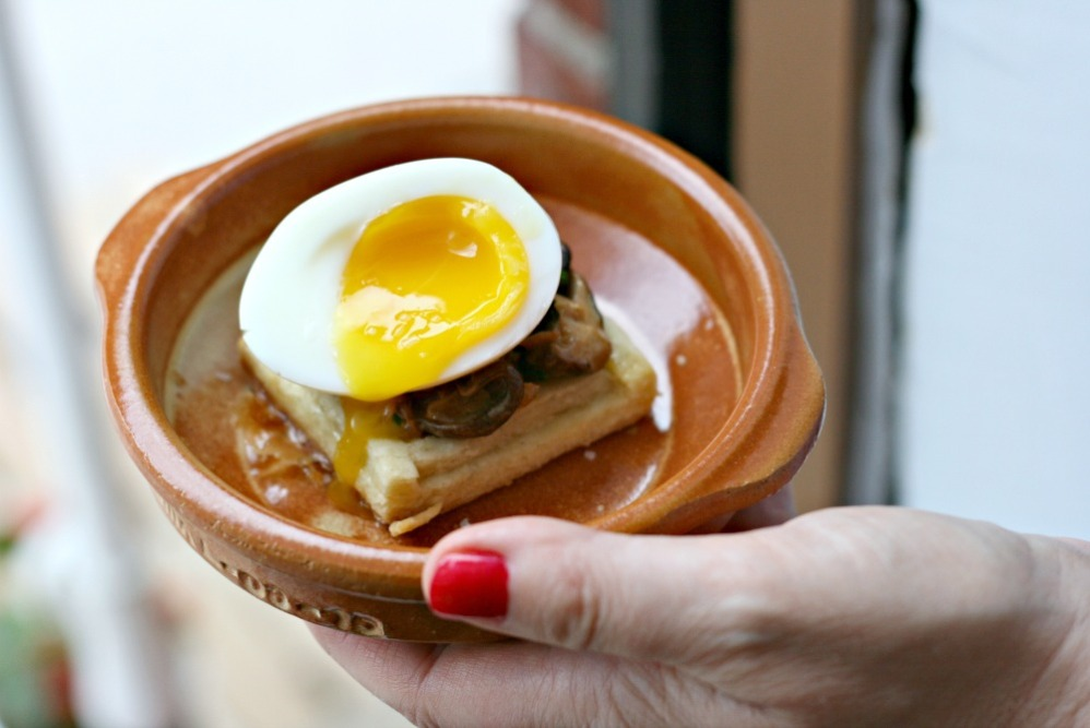 farm to chef mushroom and onion tart topped with soft boiled egg
