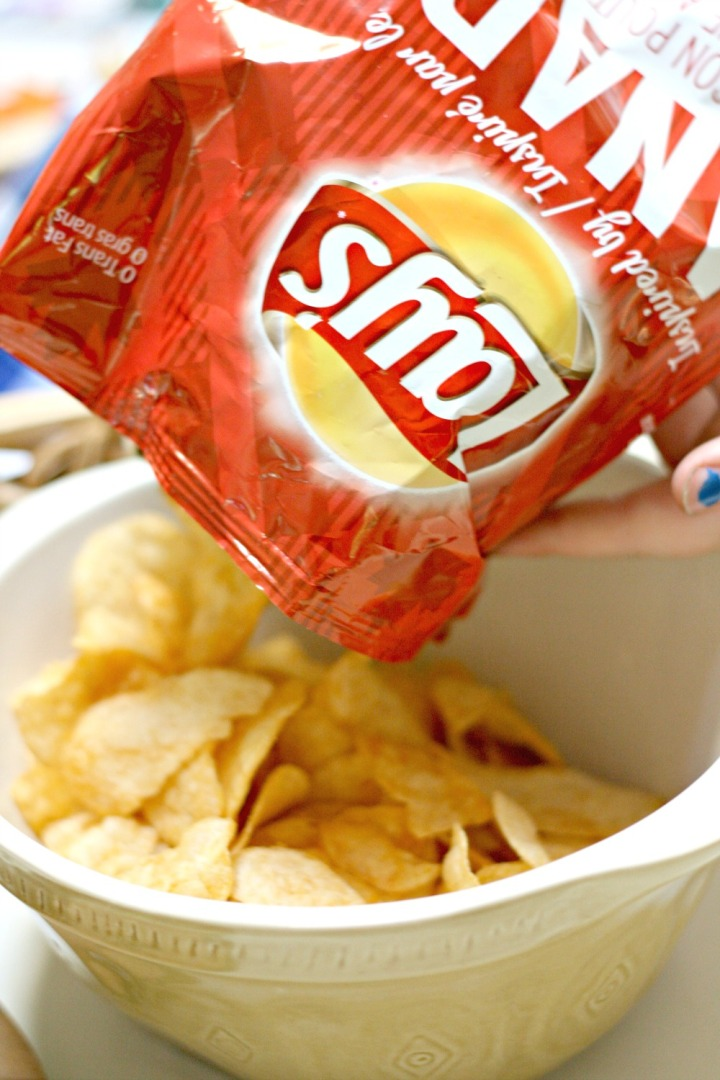 Lay's bacon poutine chips pouring