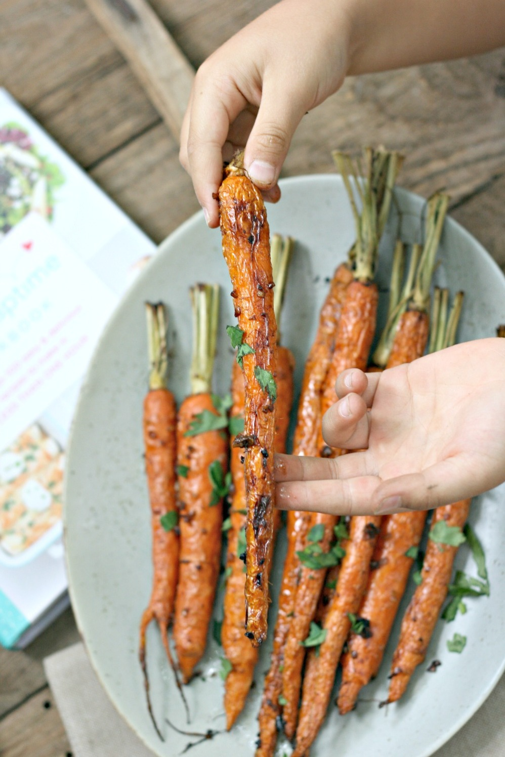 The I Heart Naptime Cookbook roasted balsamic carrots in hand