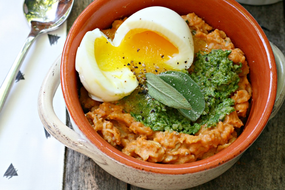 Purely Pumpkin savory herbed pumpkin oatmeal with soft-boiled eggs and pumpkin seed pesto close up