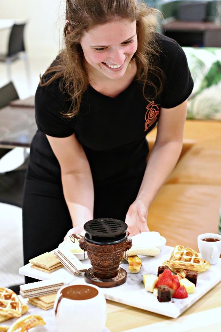 Cacao 70 Gatineau Eve serving shared platter with burner