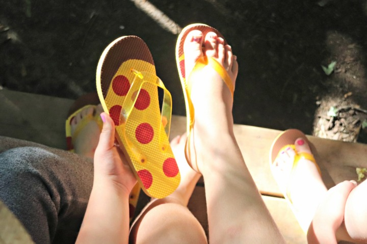 Panago Pizza pizza flip flop in hand