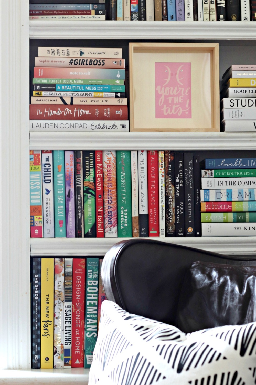 Thimblepress framed You're the Tits card on bookshelf