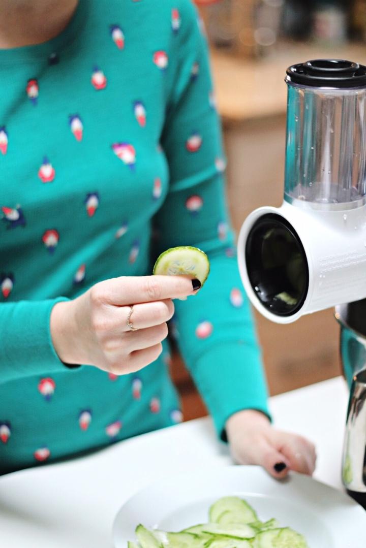 KitchenAid Fresh Prep Shredder:Slicer Attachment holiding sliced cucumber