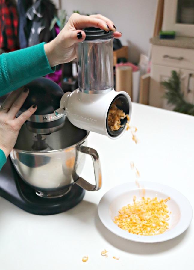 KitchenAid Fresh Prep Shredder:Slicer shredder cheese flying into bowl