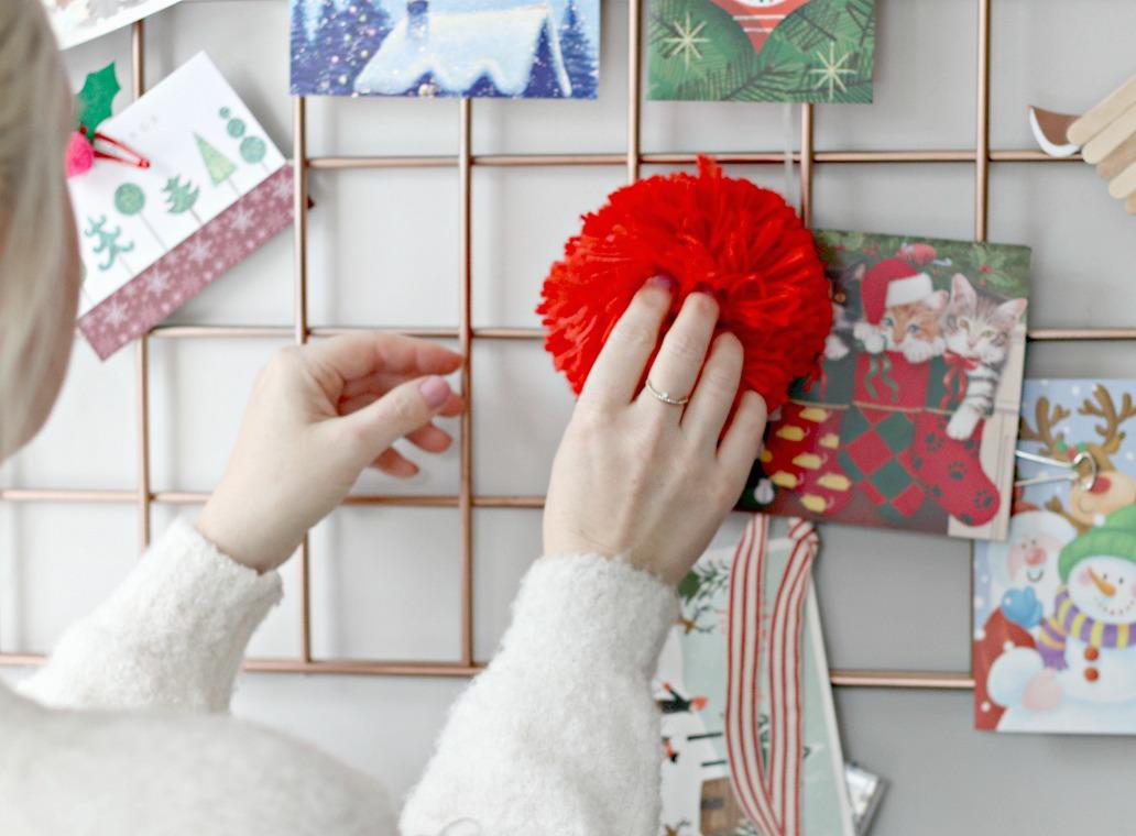 Staples pom pom magnet on Christmas card display 1
