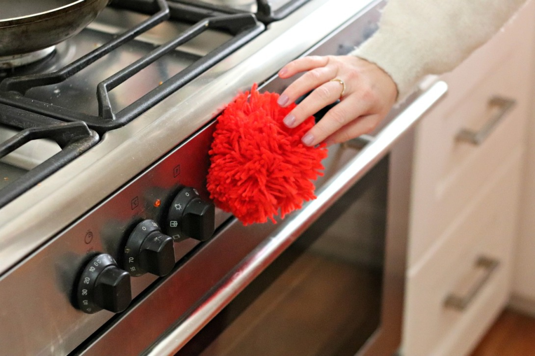Staples pom pom magnet on stove 2