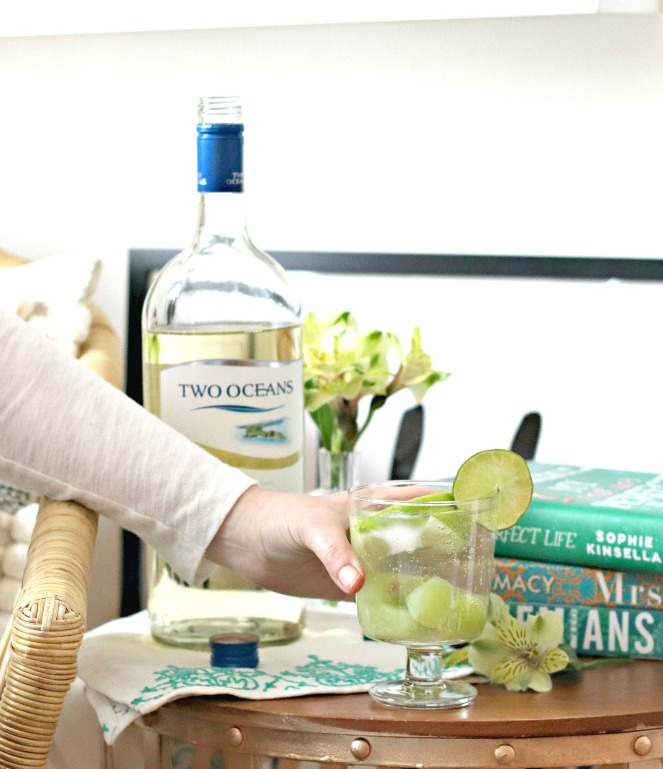 Two Oceans Green Sangria reaching for cocktail smaller