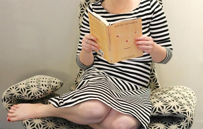 Alt Hotel reading Calypso in chair