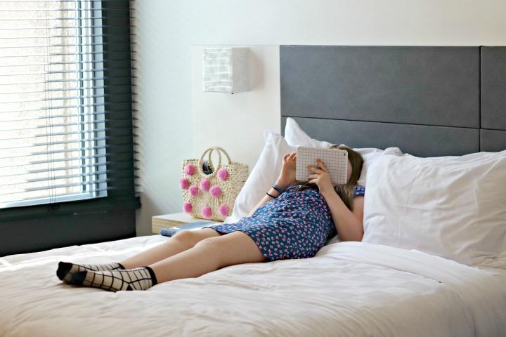 Alt hotel resting with ipad