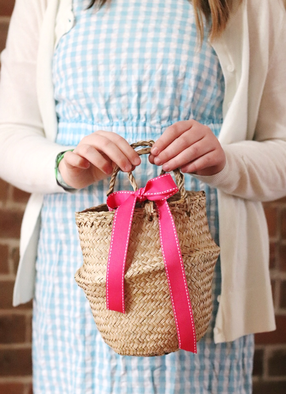 Easter basket tied with ribbon brighter