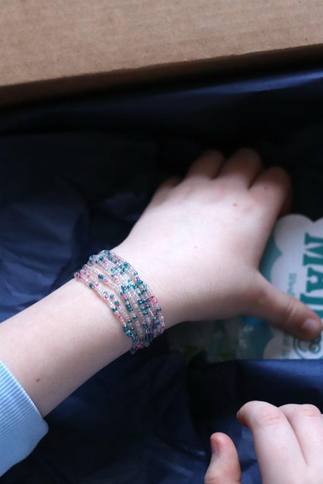 Sweet Reads Box Kids Christmas Box ages 8 to 12 Me to We Rafiki bracelet