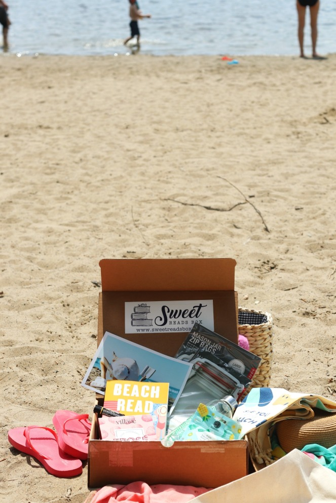 Sweet Reads Box Beach Read Box June 2020 full contents people in background but less